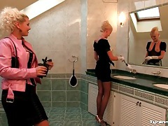 Maid and mistress play in the bathroom tubes