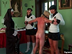 Schoolgirls and nun flog the bound man tubes