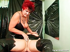Lesbian mistress puts on gloves to finger lover tubes
