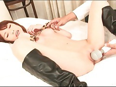 He vibrates shaved pussy of girl in boots tubes