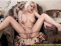 Blonde slowly teases in her sheer pantyhose tubes