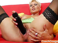 Dazzling mommy chick ellen fucks her cunt with a black dildo tubes