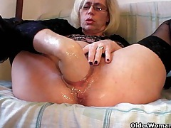 Slutty grandma in stockings fists her hairy cunt tubes