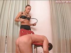 Bent over a chair to be hit by mistress tubes