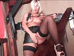 Big ass blonde mistress masturbates in dungeon tubes