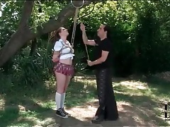 Schoolgirl in rope bondage suspension outdoors tubes