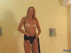 Skinny ballerina in leotard bends body tubes