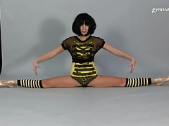 Skinny brunette does splits on camera tubes