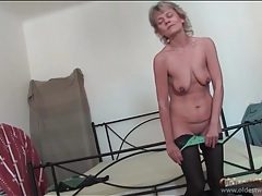 Mature with small tits models her sexy stockings tubes