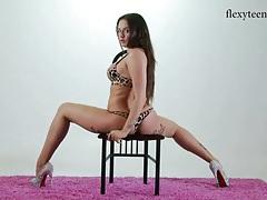 Tattooed girl in high heels is wicked flexible tubes