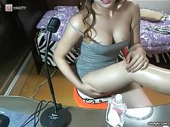 Asian webcam girl rubs baby oil on her chest tubes
