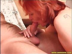 Milf redhead in sexy leather boots rides him tubes