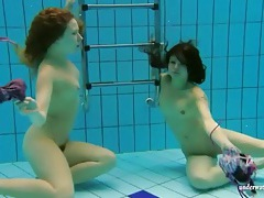 Teens go for a swim in the deep pool tubes