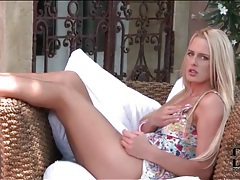 Blonde girl in short dress masturbates pussy tubes