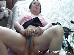 Granny masturbates with toys in bed tubes