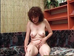 Mature masturbates hairy cunt with toy tubes