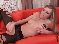 Lipstick and black lingerie on blonde beauty tubes