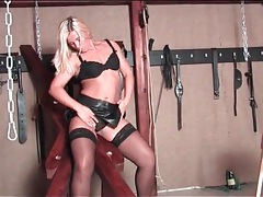 Lady in leather skirt plays solo in the dungeon tubes