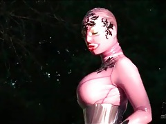 Corset and rubber catsuit on big tits babe tubes