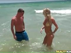 Hot milf in shiny gold bikini at the beach tubes