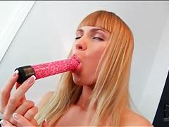 Blonde in black panties licks dildo and fucks it tubes