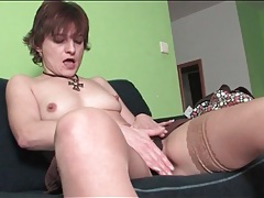 Milf in stockings sensually rubs her pussy tube