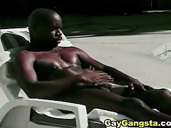 Black stud soaks up the sun and sucks cock tube
