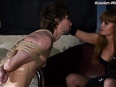 Sexy mistress threatens to cut bound guy tubes