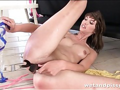 Brunette masturbates her piss soaked pussy tubes