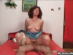 Horny old lady takes a ride on his dick tube
