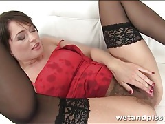 Hairy girl in sexy dress and stockings pisses tubes