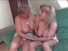 Mature lesbians kiss and suck tits on couch tubes