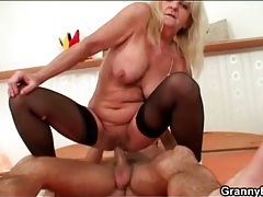 Wrinkled old babe in stockings rides cock tubes