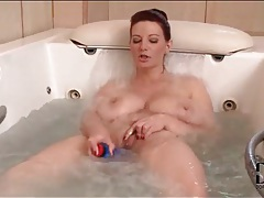 Chubby slut toy fucks pussy in bathtub tubes