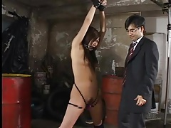 Bound girl tries to wriggle free from old man tubes