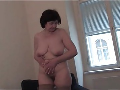 Mature strips off her dress and masturbates tubes