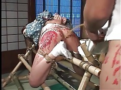 Pissing and hot wax in japanese bdsm video tubes