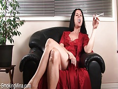 Milf in sexy satin nightgown smokes tubes