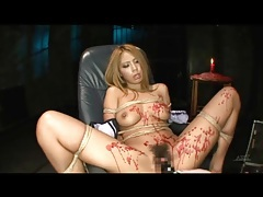 Big boobs japanese babe in bondage takes toy tubes