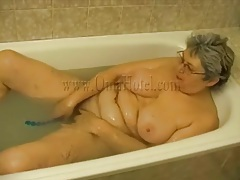 Old lady has toy sex in bathtub tubes