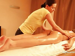 Young lady gets sexy oil massage tube