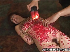 Kinky asian slavegirl gets drenched in molten wax tubes