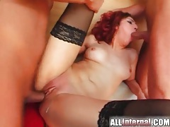 Skinny redhead rides two guys to creampie tube