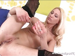 Slut in fishnets fools around with toys tubes
