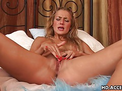 Passionate blondy monica masturbates using a strap on tubes