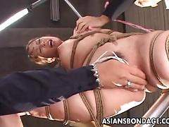 Delicious asian gal has her pussy stimulated during bondage tubes