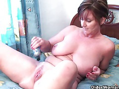 Classy grandma pushes dildo up her ass tubes