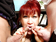 Mature redhead sucks in office tubes