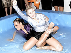 Girls wrestling in goo tubes
