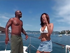 Bikini babe sucks black cock on a boat tubes